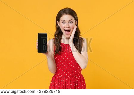 Surprised Young Brunette Woman Girl In Red Summer Dress Posing Isolated On Yellow Background. People