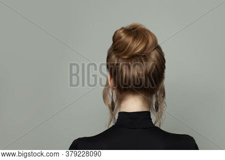 Beautiful Woman Back With Updo Hairdo On Gray Background