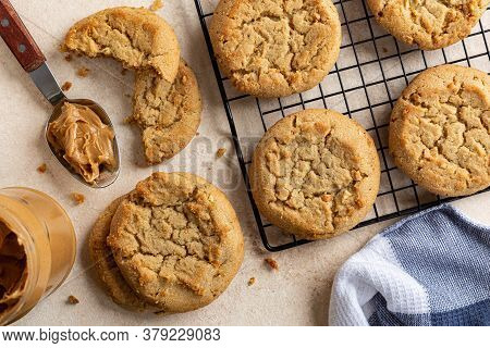 Overhead Of Peanut Butter Cookies On A Table And Cooling Rack