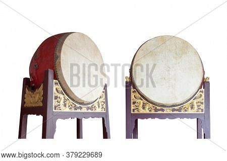 Traditional Chinese big drums on wooden frame with dragon relief isolated on the white background, this traditional drums were usually pounded  in sacrificial rites or festivals in ancient times