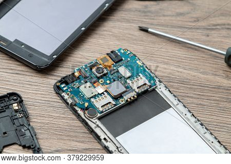Smartphone Repair Concept. The Inside Of The Smartphone. Electronic Repairing.