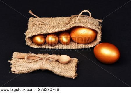 Traditional Eggs Painted In Golden Color In Burlap Bags
