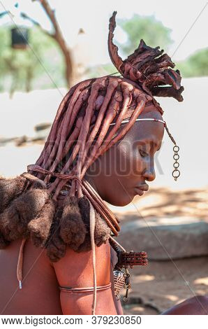 Epupa, Namibia - May 27, 2011: Profile Of A Married Himba Woman With Traditional Hair Locks And Orna