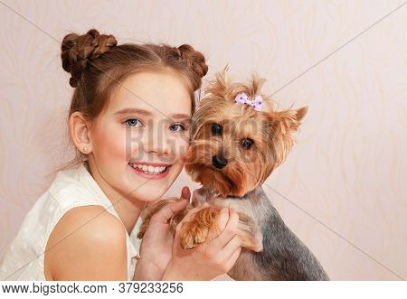 Adorable Smiling Little Girl Child Preteen Holding And Playing With Pet Dog Yorkshire Terrier