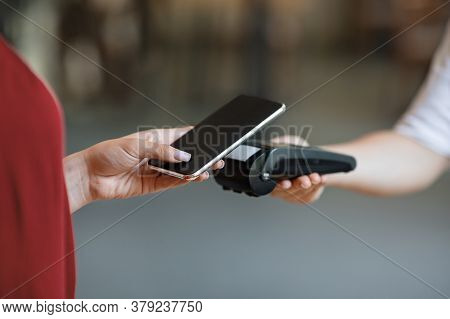 Nfc Technology. Unrecognizable Woman Maiking Contactless Payment With Smartphone To Bank Terminal El