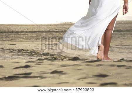 Walking Barefoot On Sand