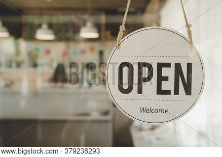 Open. Coffee Cafe Shop Text On Vintage Sign Board Hanging On Glass Door In Modern Cafe Coffee Shop,