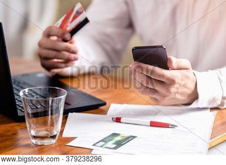 Man Buying Online With Credit Card. Online Shopping. Man Shopping Online. Male Hands Holding Credit