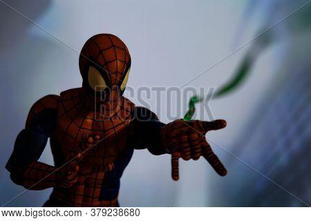 AUGUST 2 2020: Scene with Marvel comic superhero Spiderman shooting a web - Hasbro Marvel Legends figure