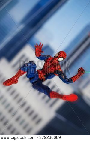 AUGUST 2 2020: Scene with Marvel comic superhero Spiderman swinging from a web  - Hasbro Marvel Legends figure