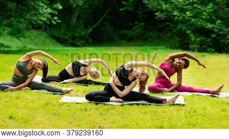 Yoga For Inner Harmony. Multinational Women On Their Morning Practice At Park. Panorama