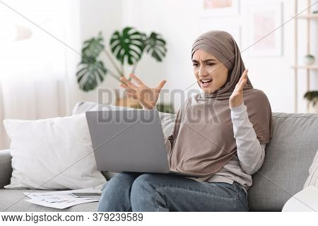 Computer Problems. Angry Arab Woman Having Issues With Laptop At Home, Annoyed Of Bad Internet Conne