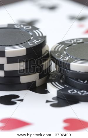 Cards And Black Poker Chips