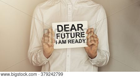 Man Take A Paper With Text Dear Future I Am Ready On The Shirt With Office Background