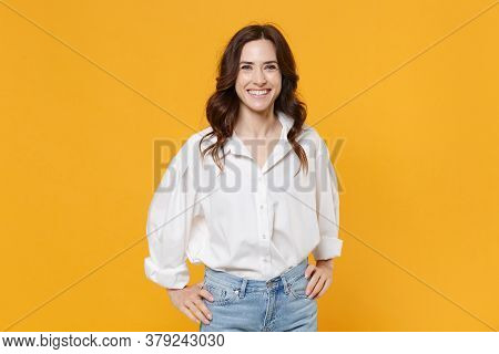 Smiling Young Brunette Business Woman In White Shirt Posing Isolated On Yellow Background Studio Por