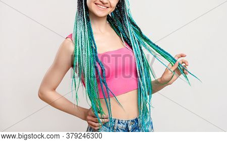 Woman With Blue Colored Hair Braids. Happy Lady In Pink With Creative Ethnic Hairstyle Isolated On W