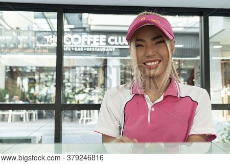 Thailand, Phuket, April 15, 2020: Cute Young Beautiful Asian Girl, Ice Cream Seller, Posing And Look