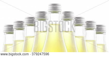 Bottles Of Yellow Soda Or Lemonade Stand In A Row