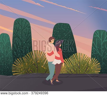 Young Woman And Man In Love, Hugging Each Other, Walking Outdoor In The Evening. Embraces Of A Lovin