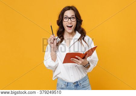 Excited Young Business Woman In White Shirt Glasses Isolated On Yellow Wall Background. Achievement