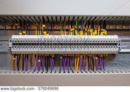 Low Voltage Electrical Connections On A Rail In A Junction Box For Signal Exchange In A Computer Con