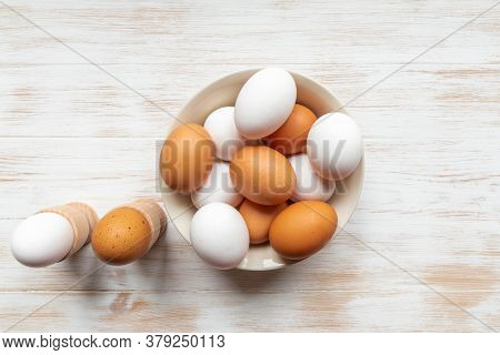 Brown And White Eggs In Bowl On Wood Background. Free-range Organic Eggs. Plate With Brown And White