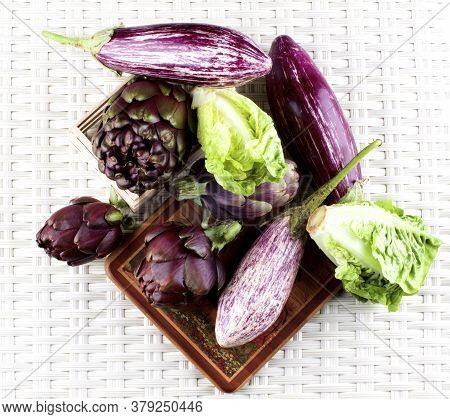 Fresh Mediterranean Vegetables With Crunchy Romaine Lettuce, Striped Eggplants And Artichokes Closeu