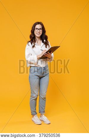 Cheerful Young Brunette Business Woman In White Shirt Glasses Isolated On Yellow Background Studio.