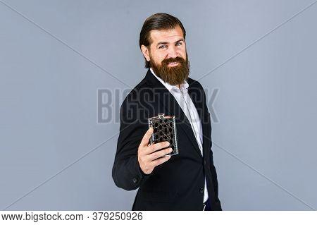 Cheers. Hip Flask For Whiskey. Vintage Gentleman Gift Shop. Brutal Businessman Drinking Alcohol. Man
