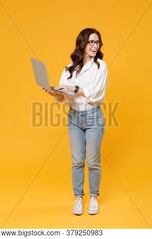 Cheerful Brunette Business Woman In White Shirt Glasses Isolated On Yellow Background. Achievement C