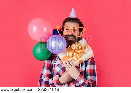 Having Fun. Funny Man In Birthday Hat. Happy Holiday Celebration. Party Goer Going Crazy. Having Fun