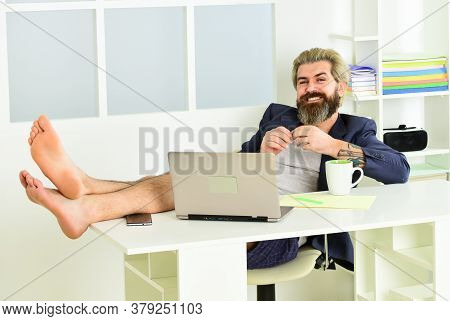 Hipster Man Tousled Hair Unshaven Face Using Laptop. Online Video Conference. Guy In Jacket Resting
