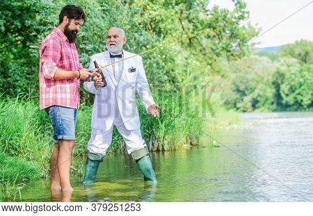 Summer Weekends Or Vacation. Fishing Excuse Drinking. Bearded Man And Elegant Businessman Fishing To