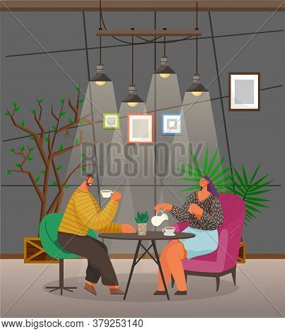People Drink Coffee And Talk With Each Other In Cozy Cafe. Man And Woman Sit On Armchairs And Have B