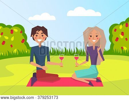 Happy Young Man And Woman, Couple In Love Holding Glasses With Drinks In Their Hands Sitting On Blan