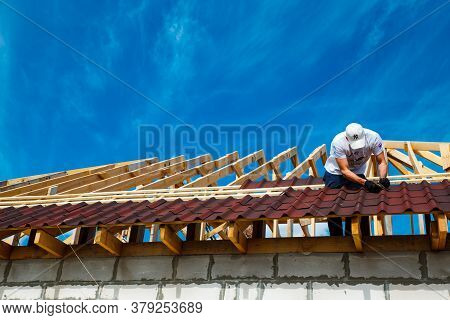 Installation Of A Wooden Roof And Closing The Roof With Onduvilla Bituminous Tiles. Woods Elements A