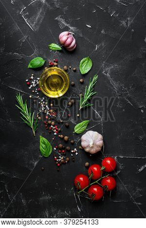 Black Stone Culinary Background With Seasonings, Spices, Vegetables, Oil. Cherry Tomatoes,garlic, Ba