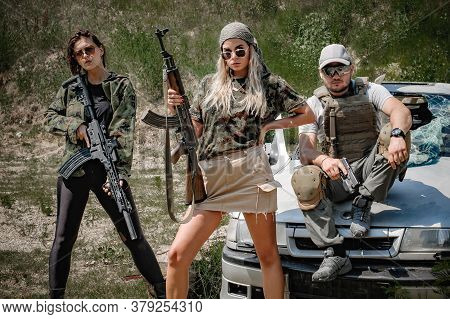 Mixed Female And Male Combat Team Squad With Weapons. Gun, Rifle And Sniper. Group Of Man And Woman
