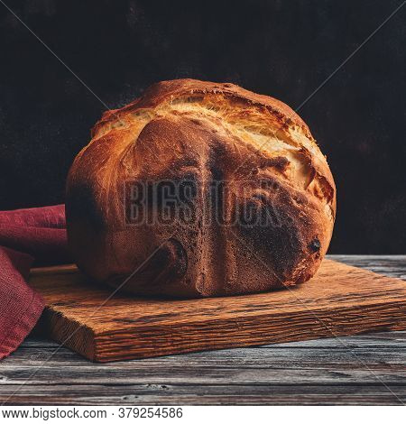 Fresh Homemade Loaf Of Bread With Crispy Toasted Crust. Selective Focus, Toned