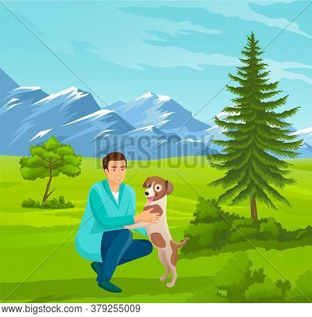 Guy Walking With His Dog At Nature. Happy Smiling Man Playing With Dog At Green Hills, Mountains Bac