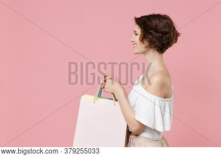 Side View Of Smiling Young Woman Girl In Summer Clothes Hold Package Bag With Purchases Isolated On