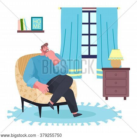 Man Sitting At Armchair In Living Room Near Window. Guy Enjoy Leisure Time Like Spend Time At Home.