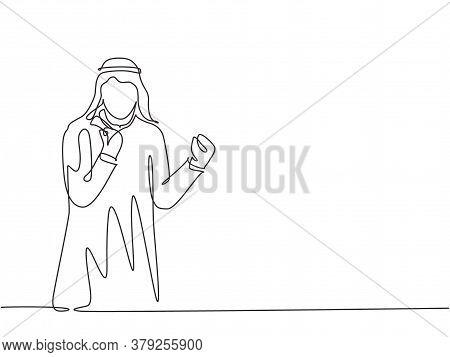 One Single Line Drawing Of Young Happy Muslim Business Man Raise Hand And Celebrate. Saudi Arabian B
