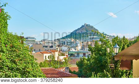 Rooftops of Plaka district and Lycabettus hill in Athens, Greece - Panoramic cityscape
