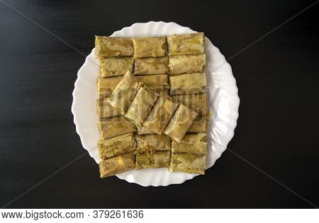Traditional Turkish, Arabic, Middle Eastern Baklava. Top View. Arabic Baked Sweets In White Plate On