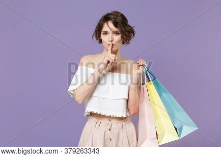 Secret Woman In Summer Clothes Hold Package Bag With Purchases Isolated On Violet Background. Shoppi