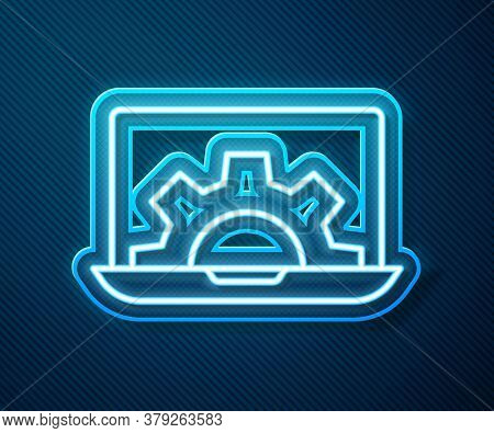 Glowing Neon Line Laptop And Gear Icon Isolated On Blue Background. Adjusting App, Setting Options,