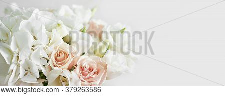 Bouquet Of Roses, Eustomas And Hydrangeas On Table. Cup Of Tea And Photo Frame. Greeting Card For Mo
