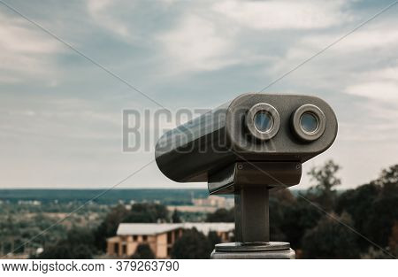 Touristic Telescope Overlooking City Park. Metallic Observation Binoculars Closeup With Left Copy Sp