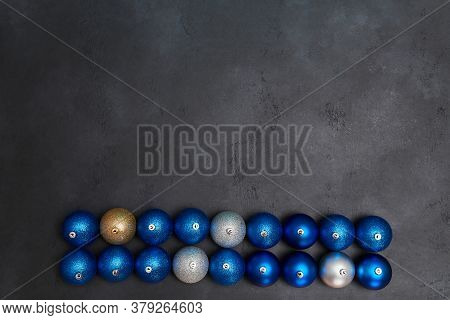 Decorative Balls In Blue Golden And Silver Colour. New Year And Christmas Holiday Concept. Copy Spac